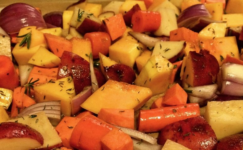 Various squashes and potatoes ready for roasting in the oven.