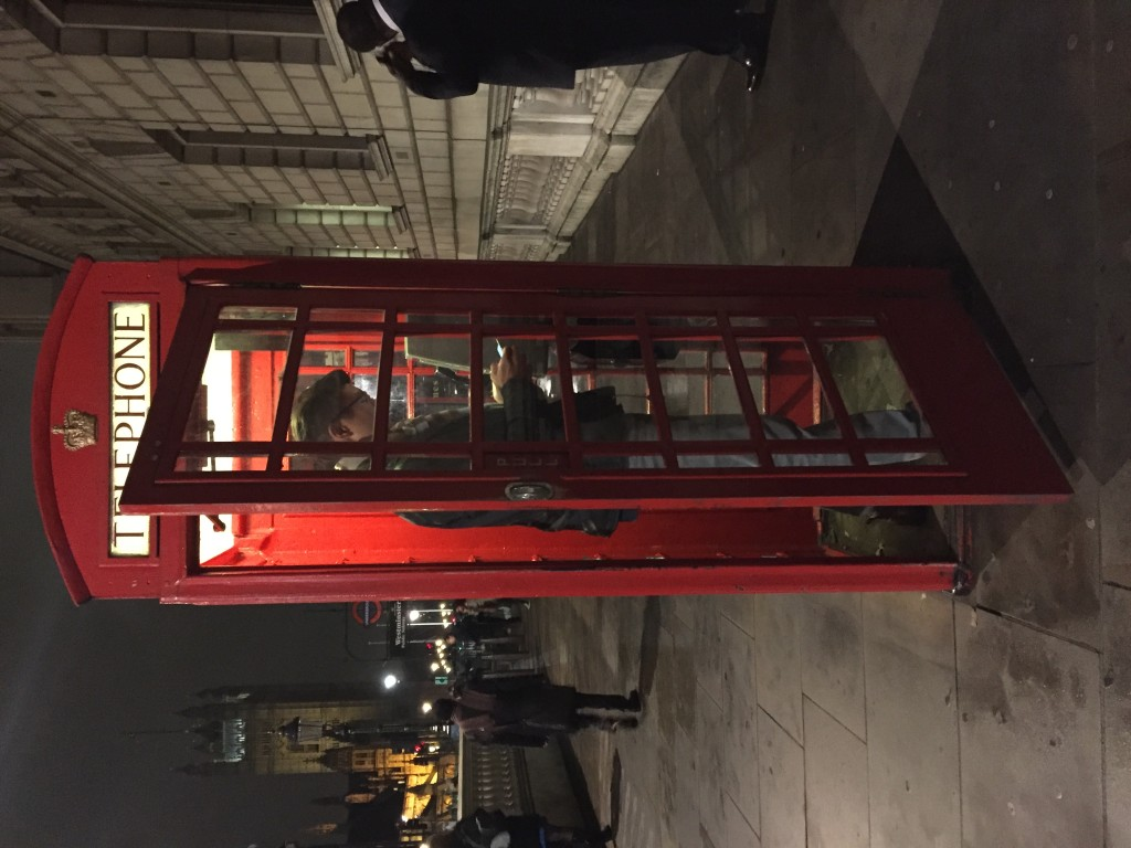 K pretending to phone in one of those quintessential London phone booths. Do they just keep them around for the tourists at this point?