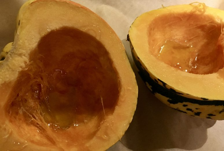 Acorn squash: split and drizzled with olive oil and honey to roast in the oven.